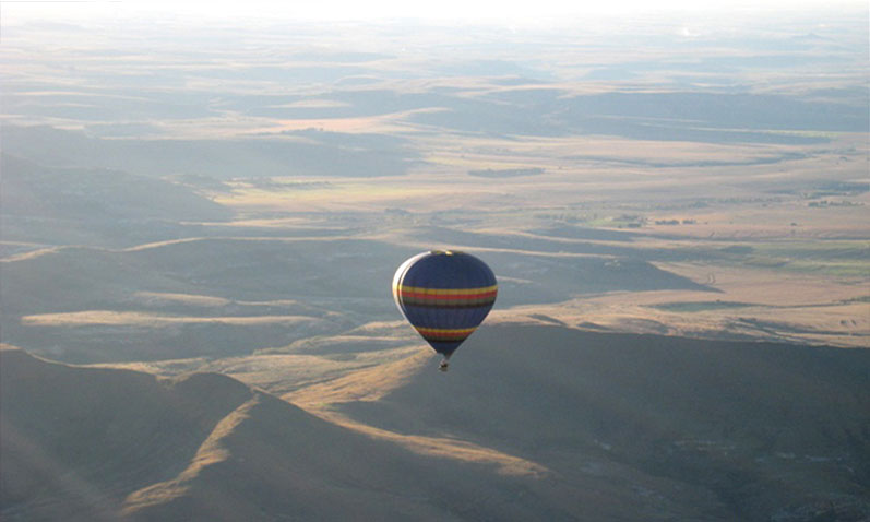 Flying over the mountains of Clarens in a hot air balloon.