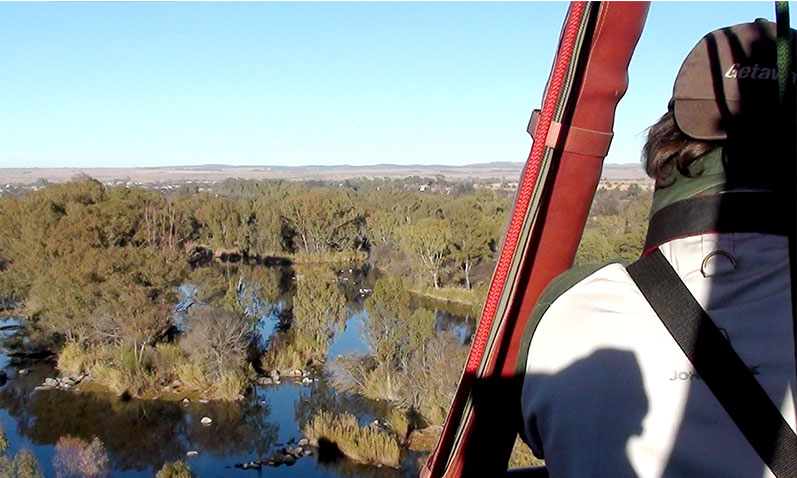 Blue skies and crystal clear waters of Parys viewed from above in a hot air balloon.