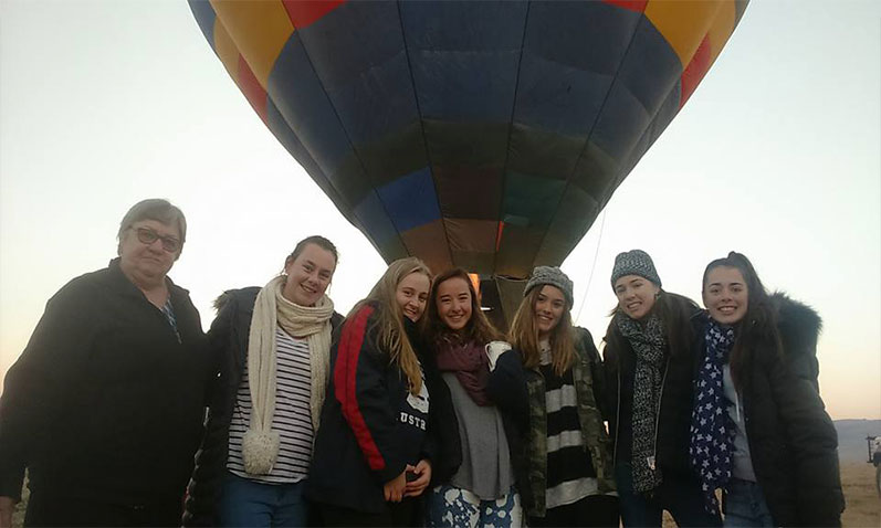 Happy passengers about to go hot air ballooning.