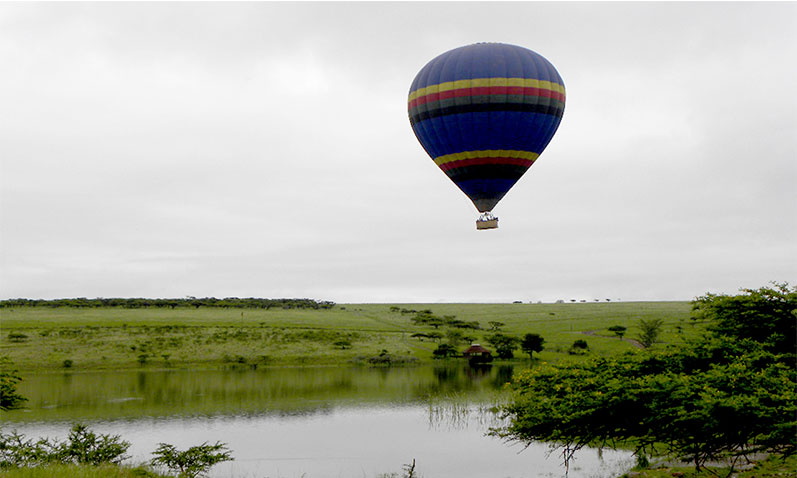 Floating gracefully over the Tala game reserve river in a hot air balloon.